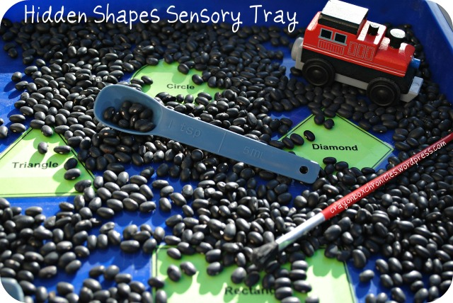 Hidden shapes bean tray for sensory play