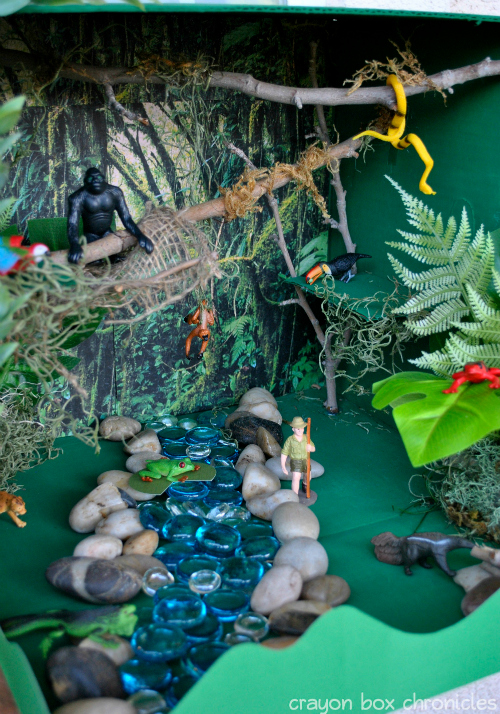 Rainforest Small World Sensory Bin by Crayon Box Chronicles