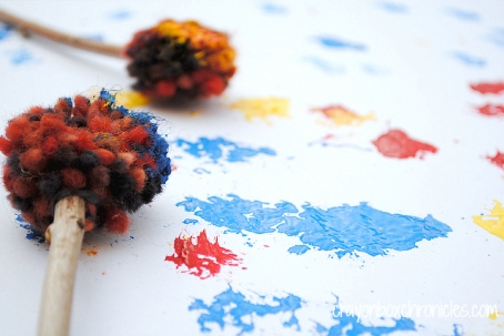 Yarn Pom Pom Drumstick Painting by Crayon Box Chronicles