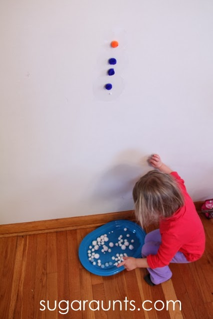 child making stick snowman craft