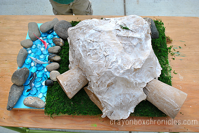 Paper mache dinosaur cave crayon box chronicles for Papier mache rocks