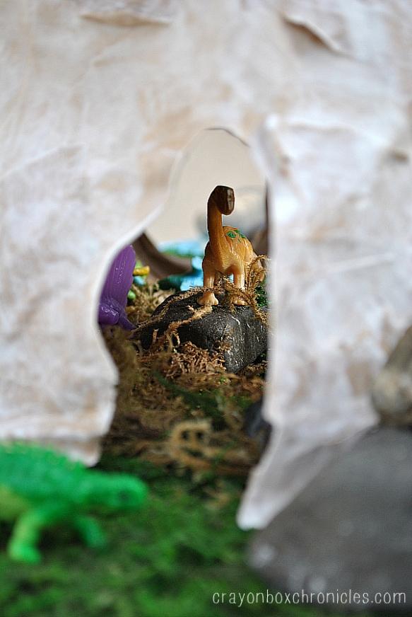 Brachiosaurus standing inside paper mache cave