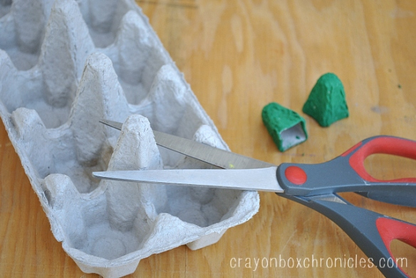 cutting egg carton to make eye holders
