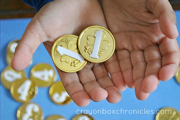 play coins with matching number inside child's hand