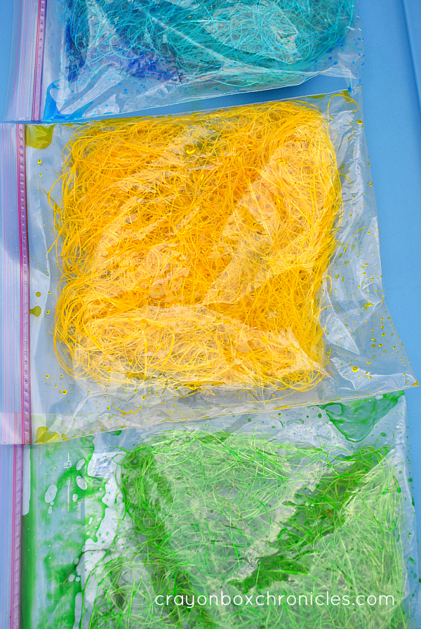coloring hay in bags for sensory play