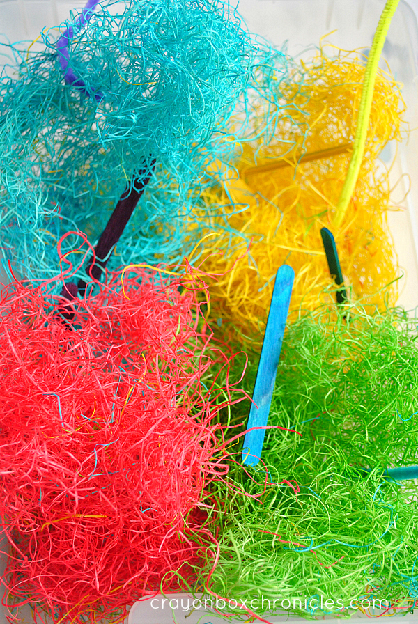 sculpting with colored hay