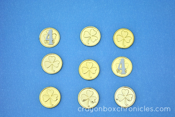 Kids memory match game with St Patty's Day coins